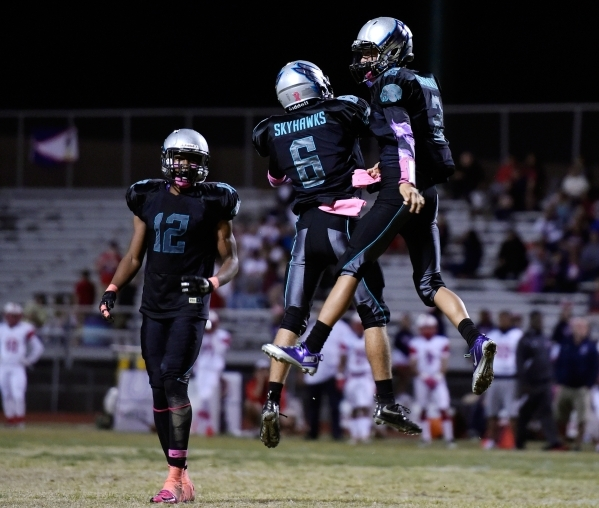 Silverado quarterback Christian Baltodano, right, celebrates his first half touchdown against Liberty with teammate Evan Tafoya (6) as Devion Clayton (12) looks on during a high school football ga ...
