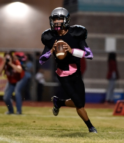 Silverado quarterback Christian Baltodano looks to pass against Liberty during the first half of a high school football game at Silverado High School on Friday, Oct. 23, 2015. David Becker/Las Veg ...