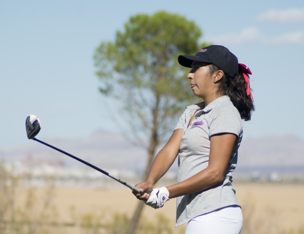 Victoria Estrada of Coronado High School watches her ball during the girls state championship golf tournament at the Primm Valley Golf Club in Nipton, Calif. on Thursday, Oct. 22, 2015. Daniel Cla ...
