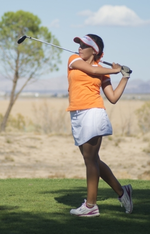 Danielle Oberlander of Bishop Gorman High School hits her ball during the girls state championship golf tournament at the Primm Valley Golf Club in Nipton, Calif. on Thursday, Oct. 22, 2015. Danie ...
