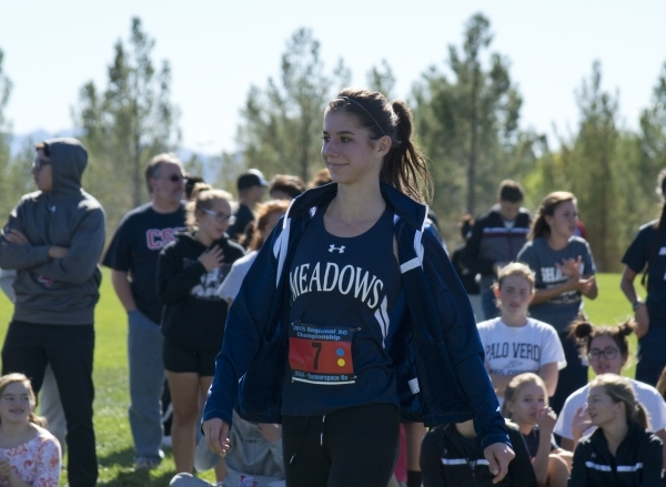 Ellen Hirsberg of The Meadows School accepts her first place medal after the girls Division III Southern cross country regional finals at Veterans Memorial Park in Boulder City on Friday, Oct. 30, ...