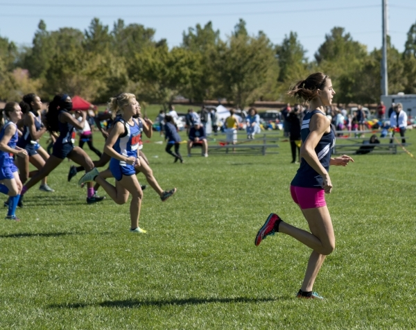 Ellen Hirsberg, in front, of The Meadows School pulls ahead at the start of the girls Division III Southern cross country regional finals at Veterans Memorial Park in Boulder City on Friday, Oct.  ...