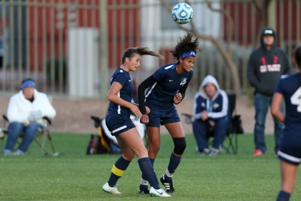Foothill's Katherine Ballou (6), left, and Rae Burrell (12), go up for the ball against Silverado in the girls Sunrise Regional semifinal game at the Bettye Wilson Soccer Complex in Las Vega ...