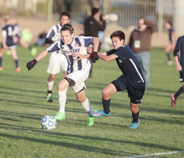 Coronado's Preston Judd (10) and Foothill's Trent Milne (4), make a move contact while moving towards the ball during the Sunrise Region boys soccer semifinal matchup at Bettye Wilson  ...