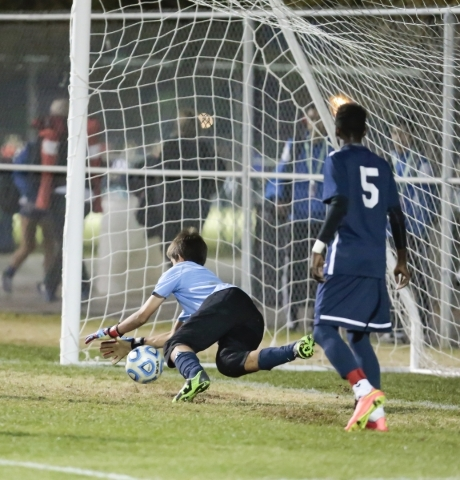 Foothill's  Ricky Glogart (GK) makes a save as Becca Nyonyintono (5) watch's during the Sunrise Region boys soccer semifinal matchup at Bettye Wilson Soccer Complex in Las Vegas, Thurs ...