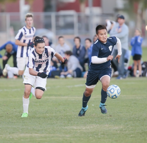 Coronado's Preston Judd (10), left, and Foothill's  Kapono Maruyama (3) sprint after the ball during the Sunrise Region boys soccer semifinal matchup at Bettye Wilson Soccer Complex in ...