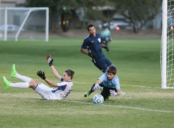 Coronado's Preston Judd (10) takes a fall as  Foothill's  goalie Ricky Glogart dives for the ball while Kyle Thomas (19) watches the ball during the Sunrise Region boys soccer semifina ...