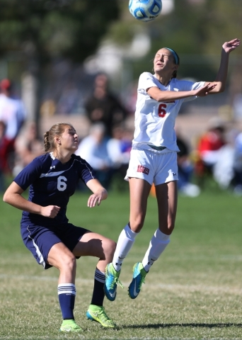 Arbor View's Samantha Blanchard (6) leaps for the ball as Centennial's Marcella Brooks (6) looks on in their Sunset Region girls championship game Saturday, Nov. 7, 2015. Arbor View wo ...