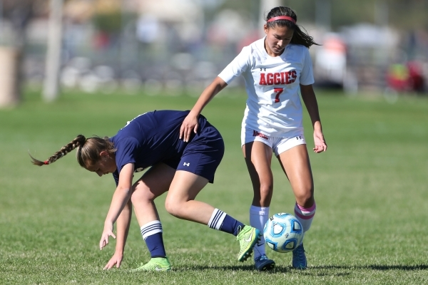 Arbor View's Katelyn Laurente (7) win the ball against Centennial's Marcella Brooks (6) in their Sunset Region girls championship game Saturday, Nov. 7, 2015. Arbor View won 4-0. Erik  ...