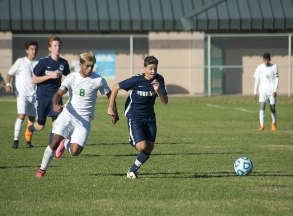 Coronado's Michael Schwob (3) attempts to outrun Green Valley's Ricardo Nunez (8) during the Sunrise Region boys soccer championship at Bettye Wilson Park on Saturday, Nov. 7, 2015. Da ...