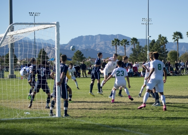 Coronado High School and Green Valley High School fight for the ball during the Sunrise Region boys soccer championship at Bettye Wilson Park on Saturday, Nov. 7, 2015. Daniel Clark/Las Vegas Revi ...