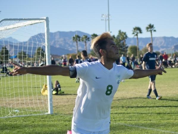 Green Valley's Ricardo Nunez (8) celebrates a goal during the Sunrise Region boys soccer championship against Coronado High School at Bettye Wilson Park on Saturday, Nov. 7, 2015. Daniel Cla ...