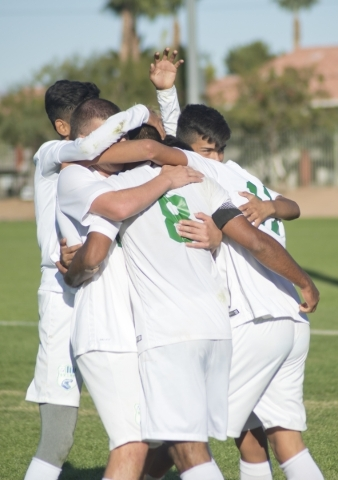 Green Valley's Ricardo Nunez (8) is congratulated by teammates after he scored a goal during the Sunrise Region boys soccer championship against Coronado High School at Bettye Wilson Park on ...