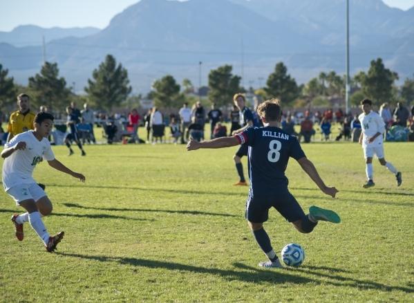 Coronado's Nick Killian (8) kicks the ball during the Sunrise Region boys soccer championship against Green Valley High School at Bettye Wilson Park on Saturday, Nov. 7, 2015. Daniel Clark/L ...