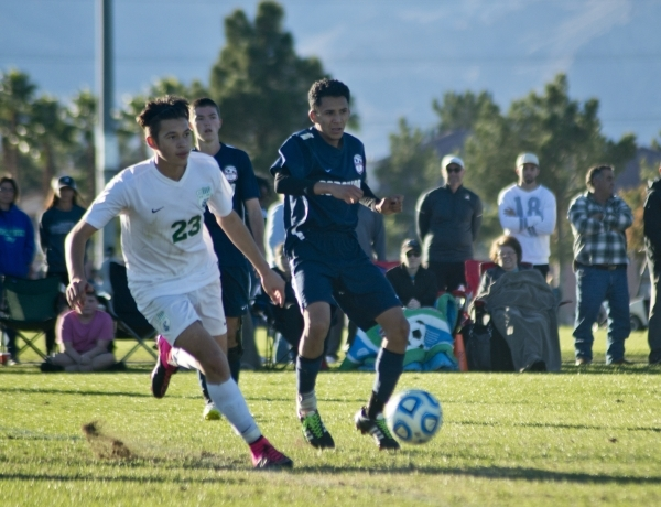 Green Valley's Alex Gibson (23) attempts to work the ball around Coronado's Nico Glass (5) during the Sunrise Region boys soccer championship at Bettye Wilson Park on Saturday, Nov. 7, ...