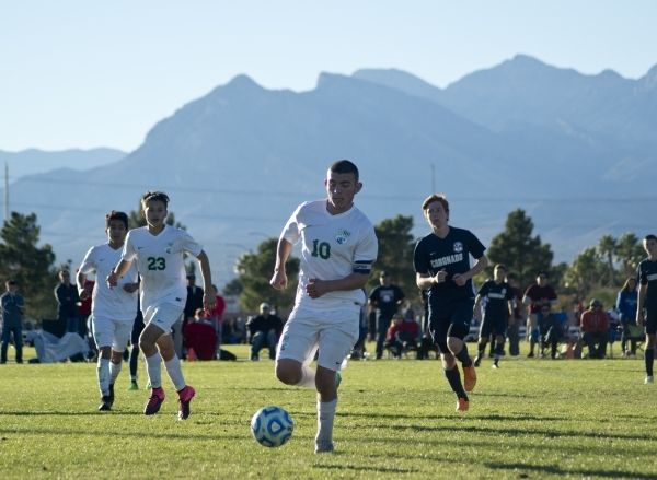 Green Valley's Connor Malone (10) takes the ball up the field during the Sunrise Region boys soccer championship against Coronado High School at Bettye Wilson Park on Saturday, Nov. 7, 2015. ...
