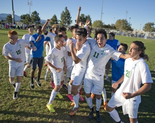The Green Valley High School boys soccer team celebrates after winning the Sunrise Region boys soccer championship against Coronado High School at Bettye Wilson Park on Saturday, Nov. 7, 2015. Dan ...