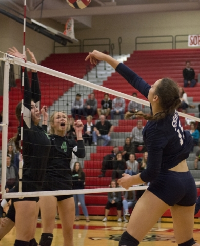 Shadow Ridge's Whittnee Nihipali (15) hits the ball over the net during the Sunset Region girls volleyball semifinal against Palo Verde High School at Arbor View High School in Las Vegas on  ...