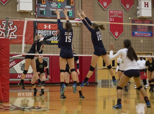 Shadow Ridge's Whittnee Nihipali (15) and Stacey Hone (10) block during the Sunset Region girls volleyball semifinal against Palo Verde High School at Arbor View High School in Las Vegas on  ...