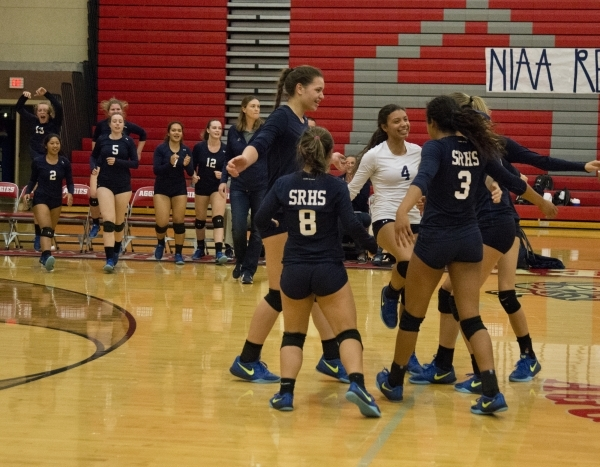 Shadow Ridge High School celebrates after winning the Sunset Region girls volleyball semifinal against Palo Verde High School at Arbor View High School in Las Vegas on Thursday, Nov. 5, 2015. Dani ...