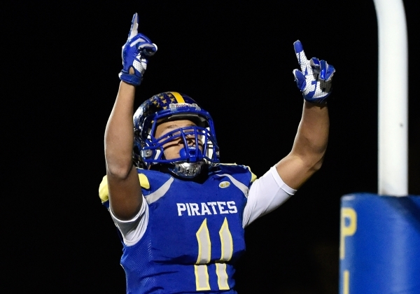 Moapa Valley's R.J. Hubert celebrates his touchdown during the fourth quarter against Desert Pines at a high school football game at Moapa Valley High School in Overton on Friday, Nov. 6, 20 ...
