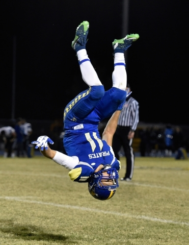 Moapa Valley's R.J. Hubert celebrates his team's victory against Desert Pines after a high school football game at Moapa Valley High School in Overton on Friday, Nov. 6, 2015. David Be ...