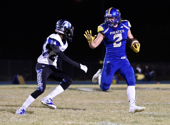 Moapa Valley's Trystin Deal runs with the ball against Desert Pines' Artise McCoy during a high school football game at Moapa Valley High School in Overton on Friday, Nov. 6, 2015. Dav ...