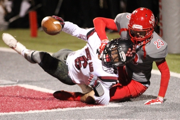 Desert Oasis Zion Jones (6) is tackled after intercepting a pass intended for Arbor View's Deago Stubbs (23) in the Sunset Regional semifinal game at Arbor View in Las Vegas Friday, Nov. 13, ...