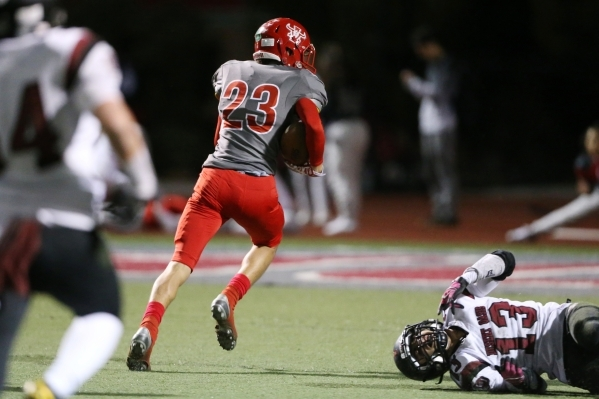 Arbor View's Deago Stubbs (23) runs the ball after a catch for a touchdown against Desert Oasis in the Sunset Regional semifinal game at Arbor View in Las Vegas Friday, Nov. 13, 2015. Arbor  ...