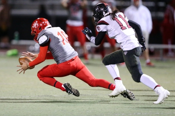 Arbor View's Carter Andrade (19) recovers his blocked kick against Desert Oasis in the Sunset Regional semifinal game at Arbor View in Las Vegas Friday, Nov. 13, 2015. Arbor View won 28-14.  ...