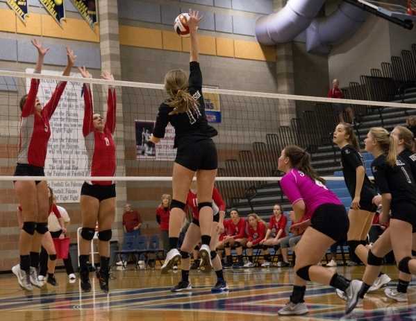 Faith Lutheran's Bobbi Tharaldson (11) hits the ball during the division I-A state volleyball final match between Faith Lutheran and Truckee at Foothill High School on Saturday, Nov. 14 2015 ...
