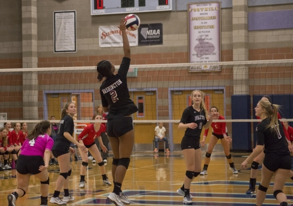 Faith Lutheran's Tayah Washington (2) hits the ball during the division I-A state volleyball final match between Faith Lutheran and Truckee at Foothill High School on Saturday, Nov. 14 2015. ...