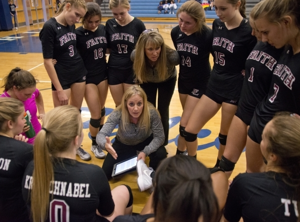 Faith Lutheran listens to their coaches during the Division I-A state volleyball final against Truckee at Foothill High School on Saturday, Nov. 14, 2015. Daniel Clark/Las Vegas Review-Journal