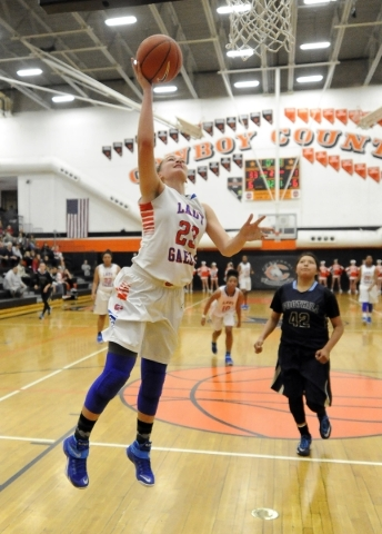 Bishop Gorman forward Raychel Stanley (23) scores on a fast break layup against Foothill in the second quarter of the Division 1 state play in game game at Chaparral High School Las Vegas, Monday, ...