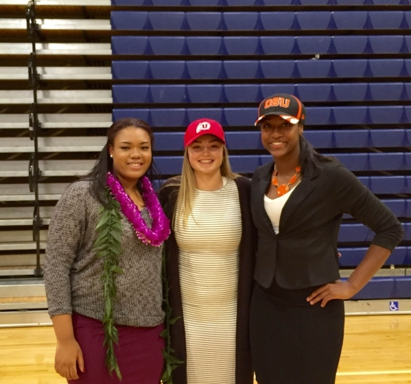 Bishop Gorman girls basketball players, from left, Raychel Stanley, Megan Jacobs and Madison Washington pose after signing their National Letters of Intent on Nov. 11, 2015. Ashton Ferguson/Las Ve ...