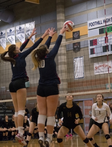 Coronado's Nikki Jackson (7) and Emily Bender (10) block the ball during the division I state volleyball final match between Coronado and Bishop Manogue at Foothill High School on Saturday,  ...