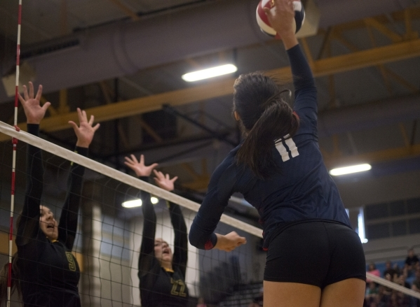 Coronado's Carolyn Andrulis (11) hits the ball during the division I state volleyball final match between Coronado and Bishop Manogue at Foothill High School on Saturday, Nov. 14 2015. Danie ...