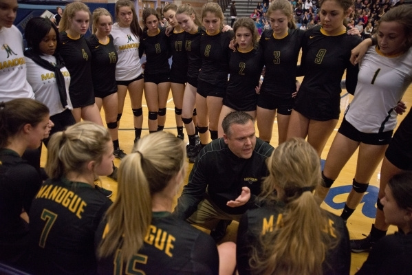 Bishop Manogue's coach Jason Sterrett talks to his team during the division I state volleyball final match between Coronado and Bishop Manogue at Foothill High School on Saturday, Nov. 14 20 ...
