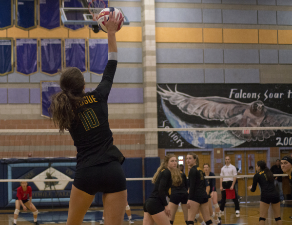 Bishop Manogue's Katelyn Oppio (10) serves during the division I state volleyball final match between Coronado and Bishop Manogue at Foothill High School on Saturday, Nov. 14 2015. Daniel Cl ...