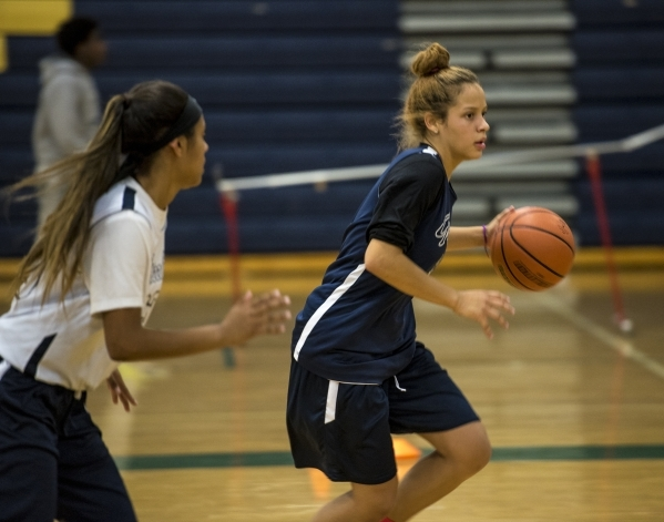 Essence Booker runs with the ball during basketball practice at Spring Valley High School in Las Vegas on Wednesday, Nov. 18, 2015. Joshua Dahl/Las Vegas Review-Journal