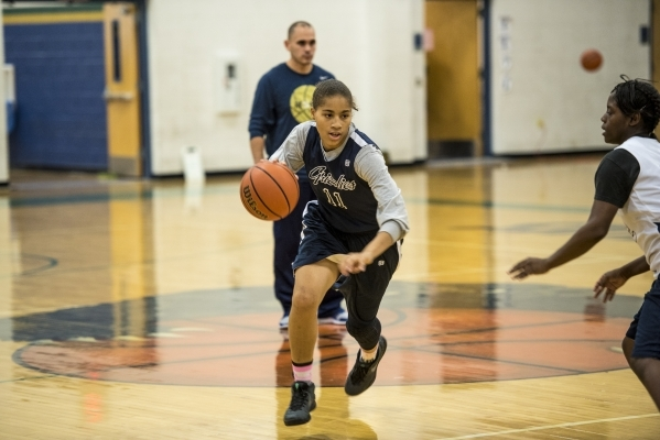 Kayla Harris runs with the ball during basketball practice at Spring Valley High School in Las Vegas on Wednesday, Nov. 18, 2015. Joshua Dahl/Las Vegas Review-Journal