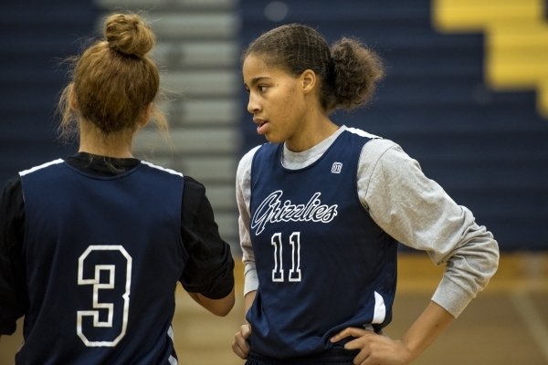 Kayla Harris, right, talks with Essence Booker during basketball practice at Spring Valley High School in Las Vegas on Wednesday, Nov. 18, 2015. Joshua Dahl/Las Vegas Review-Journal