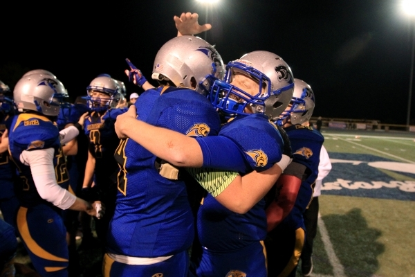 Pahranagat Valley players celebrate their 66-34 win over Spring Mountain during their championship game Friday, Nov. 21, 2014. (Sam Morris/Las Vegas Review-Journal)