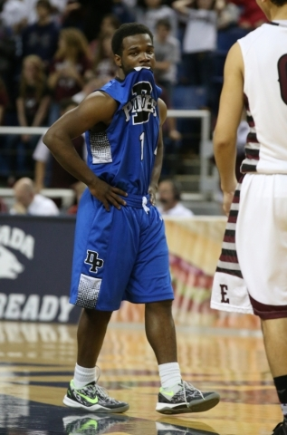 Desert Pines' Capri Uzan watches the clock tick down during a Division IA semi-final game against Elko in the NIAA state tournament at Lawlor Events Center, in Reno, Nev., on Friday, Feb. 28 ...