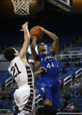 Desert Pines' Trevon Abdullah shoots past Elko defender Nathan Klekas during the NIAA basketball state tournament at Lawlor Events Center, in Reno, Nev., on Friday, Feb. 28, 2014. Elko won 6 ...