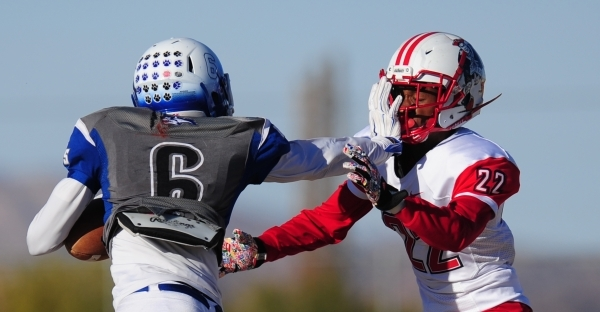 Basic Wolves wide receiver cornerback Deondre Ishman (6) facemasks Liberty cornerback Alan Mwata (22) in the second half of the NIAA Division 1 Sunrise Region Football Final prep football game at  ...