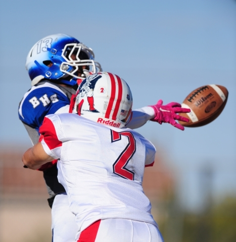 Basic Wolves wide receiver De'Shawn Eagles (13) is unable to make a catch as Liberty cornerback Ethan Dedeaux (2) interferes in the first half of the NIAA Division 1 Sunrise Region Football  ...