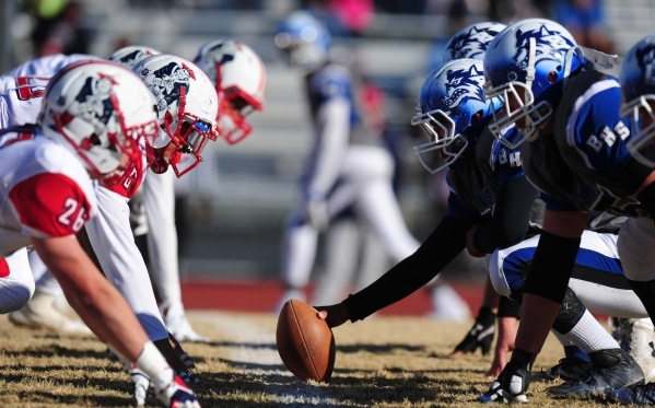 The Basic Wolves offensive line and the Liberty defensive line are seen in the second half of the NIAA Division 1 Sunrise Region Football Final prep football game at Basic High School in Henderson ...