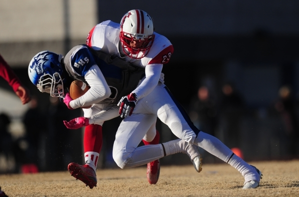 Liberty linebacker Alan Ewell (29) tackles Basic Wolves wide receiver De'Shawn Eagles in the second half of the NIAA Division 1 Sunrise Region Football Final prep football game at Basic High ...