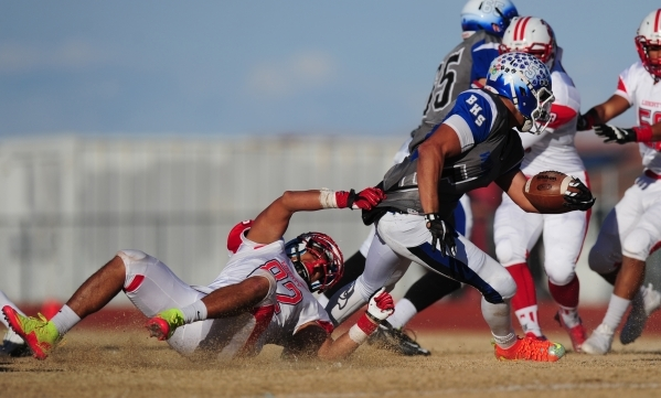 Liberty linebacker Cyrus Vea (82) tackles Basic Wolves running back Tay'Jean Thomas in the second half of the NIAA Division 1 Sunrise Region Football Final prep football game at Basic High S ...